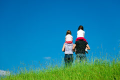 Family Standing At The Top Of A Hill Royalty Free Stock Photos