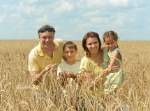 Family standing on wheat field Royalty Free Stock Photography