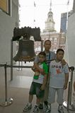Family stands in front of Liberty Bell Royalty Free Stock Photography