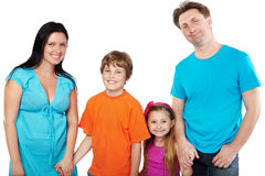Family stands holding hands. Stock Photography