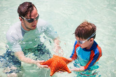 Family with starfish Stock Photos