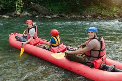 Family starting rafting on a mountain river. royalty free stock photography