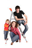 Family on step-ladder. Family with little girl on step-ladder royalty free stock images