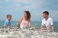 Family and  stone stacks on beach Royalty Free Stock Photography