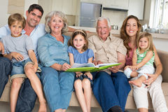 Family with storybook at home Royalty Free Stock Image