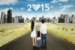 Family on the street with numbers 2015 Stock Photo