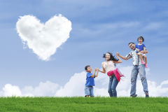 Family stroll and heart clouds Royalty Free Stock Photos