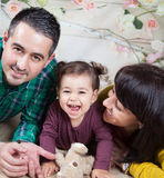 Family of 3 in studio Royalty Free Stock Photo