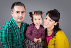 Family of 3 in studio Royalty Free Stock Images