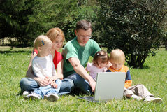 Family studying the laptop Stock Image