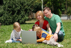 Family studying the laptop Stock Photo