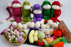 Family, stuffed animal, new year, monkey, funny. Family of stuffed animal sit at new year party, group of knitted monkey in colorful yarn, symbol of 2016, funny royalty free stock photography