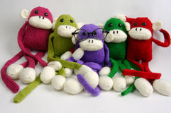 Family, stuffed animal, new year, monkey, funny. Family of stuffed animal sit at new year party, group of knitted monkey in colorful yarn, symbol of 2016, funny stock photography