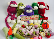 Family, stuffed animal, new year, monkey, funny. Family of stuffed animal sit at new year party, group of knitted monkey in colorful yarn, symbol of 2016, funny royalty free stock photo