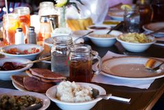 Family style meal. A table loaded down with food for a family feast stock photography
