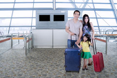 Family with suitcase standing in airport Stock Photos
