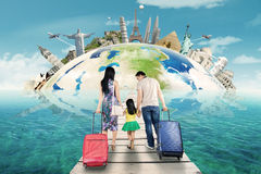 Family with suitcase and the world landmark Royalty Free Stock Image