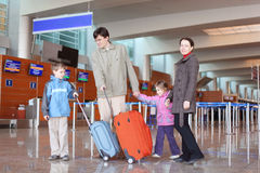 Family with suitcases in airport hall royalty free stock photos