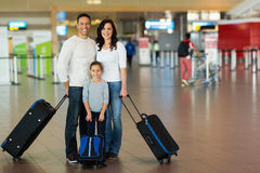 Family suitcases airport. Happy family with suitcases at airport Royalty Free Stock Photos
