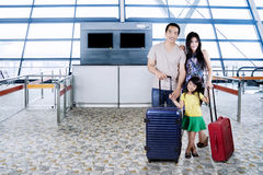 Family with suitcases in the airport terminal Royalty Free Stock Photos