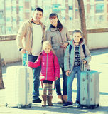 Family with suitcases in journey. Mother, father and two girls  with suitcases in journey Stock Photos