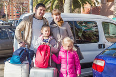 Family with suitcases in journey Stock Image