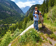 Family in summer Alps mountain (Switzerland). Royalty Free Stock Image