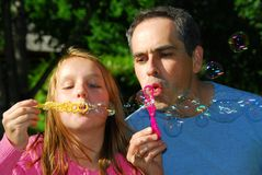 Family summer bubbles stock images