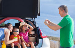 Family summer holiday sitting in car. Royalty Free Stock Photo