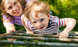 Family summer on ladder to tree house Royalty Free Stock Images