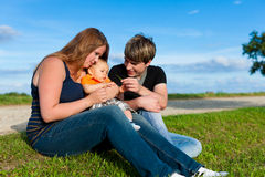 Family in summer - Mother, father and child Royalty Free Stock Photo