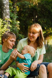 Family in summer nature. Happy young family in summer nature Royalty Free Stock Photography