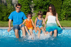 Family summer vacation near swimming pool Stock Photography