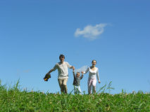 Family sunny day. On green grass stock photography