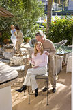 Family on sunny patio Royalty Free Stock Photo