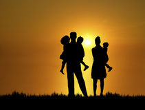 Family at Sunset 2. Silhouette of family at sunset Stock Photo