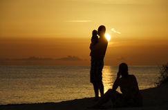 Family at Sunset. A family watching a golden sunset over the Gulf of Mexico Stock Images
