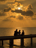 Family at sunset. Silhouette of family watching the sun go down Royalty Free Stock Images