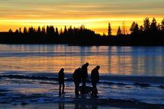 Family at sunset stock photos