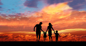 Family in the sunset background. Royalty Free Stock Photo
