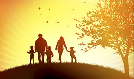 Family at sunset Royalty Free Stock Image