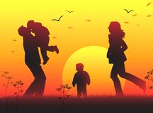 Family sunset silhouette Royalty Free Stock Images