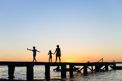 Family sunset silhouettes Royalty Free Stock Photo