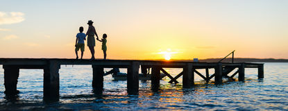 Family sunset silhouettes Royalty Free Stock Photography