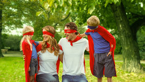 Family in superhero costume in park Royalty Free Stock Photo