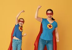 Family in Superhero costumes stock photography