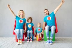 Family of superheroes playing at home stock photos