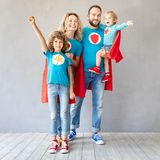Family of superheroes playing at home stock images