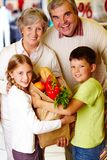 Family in supermarket Stock Photo