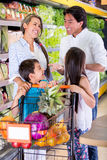 Family at the supermarket Stock Photos